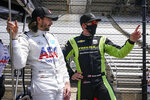 JR Hildebrand, left, talks with Charlie Kimball during practice for the Indianapolis 500 auto race at Indianapolis Motor Speedway in Indianapolis, Thursday, May 20, 2021. (AP Photo/Michael Conroy)