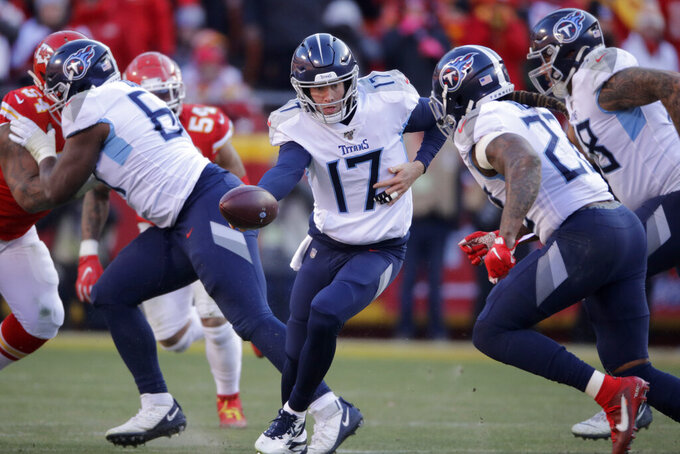 FILE - In this Jan. 19, 2020, file photo, Tennessee Titans quarterback Ryan Tannehill (17) looks to hand the ball off during the first half of the AFC championship NFL football game against the Kansas City Chiefs in Kansas City, Mo. The Tennessee Titans are confident enough Ryan Tannehill can repeat the best season of his career, or close enough, that they gave him a four-year, $118 million contract. (AP Photo/Charlie Riedel, File)