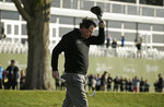 Phil Mickelson tips his hat on the 18th green of the Pebble Beach Golf Links after winning the AT&T Pebble Beach Pro-Am golf tournament Monday, Feb. 11, 2019, in Pebble Beach, Calif. (AP Photo/Eric Risberg)