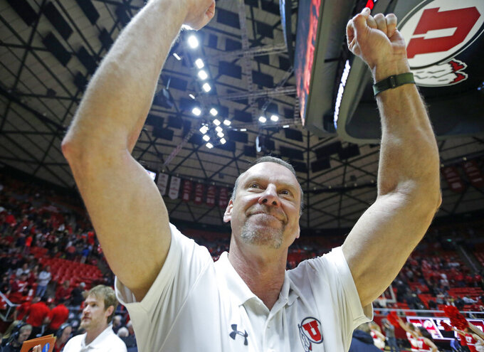 Utah head coach Larry Krystkowiak gestures to fans following an NCAA college basketball game against Washington State, Saturday, Jan. 12, 2019, in Salt Lake City. (AP Photo/Rick Bowmer)