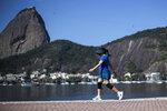 A woman walks past Sugarloaf Mountain in Rio de Janeiro, Brazil, Friday, July 23, 2021, during the COVID-19 pandemic. (AP Photo/Bruna Prado)