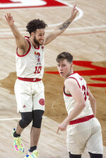 Nebraska guard Kobe Webster (10) celebrates after teammate Thorir Thorbjarnarson (34) made a 3-pointer against Minnesota during the second half of an NCAA college basketball game Saturday, Feb. 27, 2021, in Lincoln, Neb. (Francis Gardler/Lincoln Journal Star via AP)