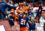 Syracuse running back Moe Neal (21) celebrates his touchdown with fans during the second half of an NCAA college football game against Wake Forest in Syracuse, N.Y., Saturday, Nov. 30, 2019. Syracuse beat Wake Forest 39-30 in overtime. (AP Photo/Adrian Kraus)