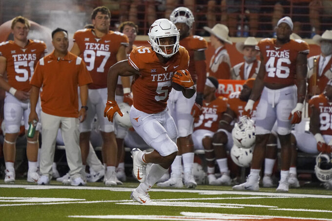 Texas running back Bijan Robinson (5) breaks away for a long touchdown run against the Rice during the first half of an NCAA college football game on Saturday, Sept. 18, 2021, in Austin, Texas. (AP Photo/Chuck Burton)