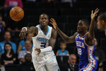 Charlotte Hornets guard Terry Rozier III, left, passes around Philadelphia 76ers guard Shake Milton in the first half of a preseason NBA basketball game in Winston-Salem, N.C., Friday, Oct. 11, 2019. (AP Photo/Nell Redmond)
