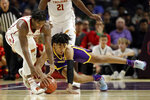 LSU forward Trendon Watford, right, dives for the ball next to Southern California guard Ethan Anderson during the first half of an NCAA college basketball game Saturday, Dec. 21, 2019, in Los Angeles. (AP Photo/Marcio Jose Sanchez)