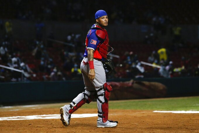 Puerto Rico catcher Yadier Molina walk to the dugout after the first inning against the Dominican Republic in the Caribbean Series baseball final at Teodoro Mariscal stadium in Mazatlan, Mexico, Saturday, Feb. 6, 2021. (AP Photo/Moises Castillo)