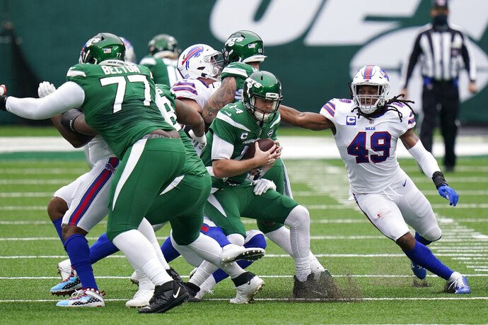 New York Jets quarterback Sam Darnold, center, is sacked by the Buffalo Bills during the first half of an NFL football game, Sunday, Oct. 25, 2020, in East Rutherford, N.J. (AP Photo/Frank Franklin II)