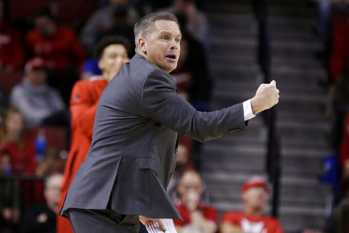 Ohio State coach Chris Holtmann gestures during the first half of an NCAA college basketball game against Nebraska in Lincoln, Neb., Thursday, Feb. 27, 2020. (AP Photo/Nati Harnik)