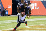 Chicago Bears quarterback Justin Fields runs with the ball during the first half of an NFL preseason football game against the Miami Dolphins in Chicago, Saturday, Aug. 14, 2021. (AP Photo/Nam Y. Huh)