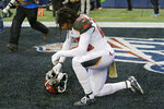 Tampa Bay Buccaneers cornerback Vernon III Hargreaves kneels in the end zone after the Seattle Seahawks defeated his team in overtime in an NFL football game, Sunday, Nov. 3, 2019, in Seattle. (AP Photo/John Froschauer)