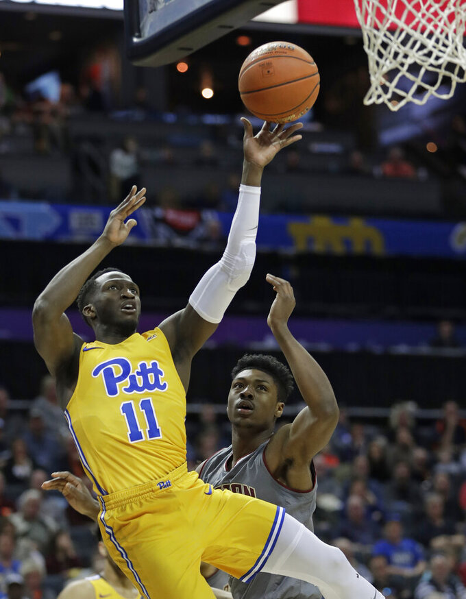 Pittsburgh's Sidy N'Dir (11) shoots against Boston College's Jared Hamilton during the first half of an NCAA college basketball game in the Atlantic Coast Conference men's tournament in Charlotte, N.C., Tuesday, March 12, 2019. (AP Photo/Nell Redmond)