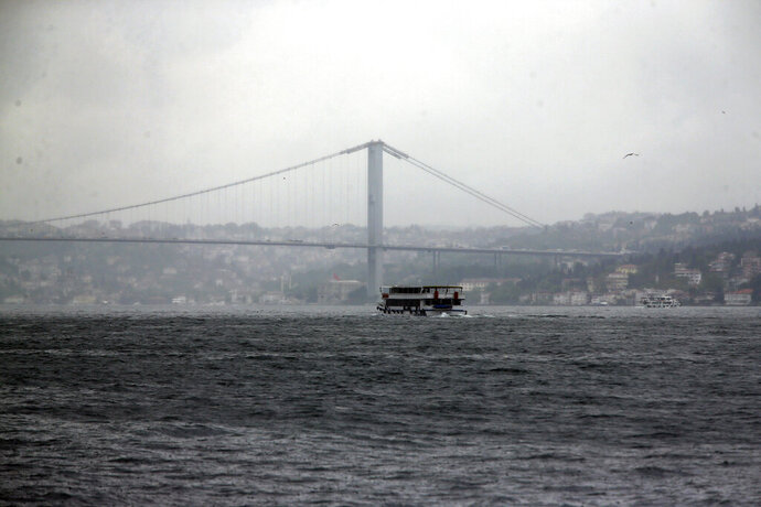 A boat crosses the Bosporus Strait in Istanbul, Tuesday, May 7, 2019. Ruling in favor of Turkey's President Recep Tayyip Erdogan's governing party, Turkey's top electoral body on Monday annulled the results of the March 31 vote in Istanbul which the opposition candidate Ekrem Imamoglu narrowly won and scheduled a re-run for June 23.Erdogan insisted Tuesday that the repeat of the mayoral race in Istanbul will strengthen democracy and lift the shadow that was cast over the vote.(AP Photo/Lefteris Pitarakis)