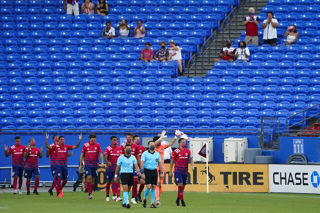 FC Dallas player acknowledges supporters as they take the field before an MLS soccer game against the Nashville SC at Toyota Stadium on Wednesday, Aug. 12, 2020, in Frisco, Texas. (Smiley N. Pool/The Dallas Morning News via AP)