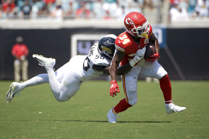 Kansas City Chiefs running back Darwin Thompson (34) is tackled by Jacksonville Jaguars linebacker Quincy Williams during the first half of an NFL football game, Sunday, Sept. 8, 2019, in Jacksonville, Fla. (AP Photo/Phelan M. Ebenhack)