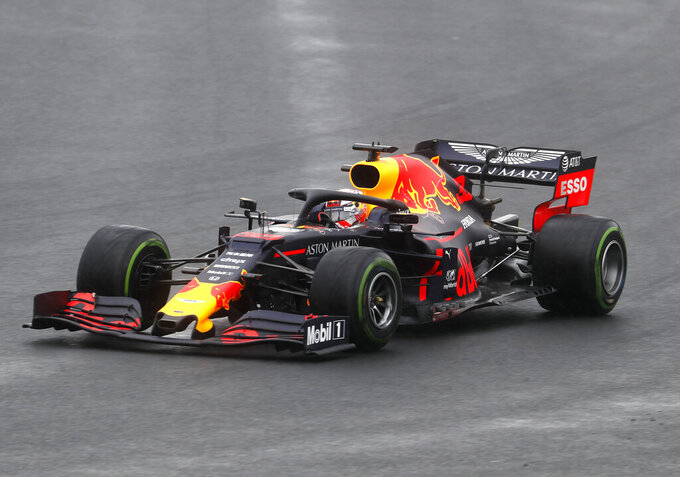 Red Bull driver Max Verstappen of the Netherland's steers his car during the second practice session of the Hungarian Formula One Grand Prix at the Hungaroring racetrack in Mogyorod, northeast of Budapest, Hungary, Friday, Aug. 2, 2019. The Hungarian Formula One Grand Prix takes place on Sunday. (AP Photo/Laszlo Balogh)