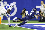 Tennessee Titans wide receiver Kalif Raymond (14) dives into the end zone after a catch behind Indianapolis Colts defensive back Rolan Milligan (42) during the second half of an NFL football game in Indianapolis, Sunday, Dec. 1, 2019. (AP Photo/Darron Cummings)