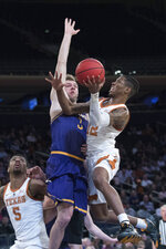 Texas guard Kerwin Roach II (12) goes to the basket against Lipscomb guard Michael Buckland (3) during the first half of an NCAA college basketball game for the NIT championship Thursday, April 4, 2019, at Madison Square Garden in New York. (AP Photo/Mary Altaffer)