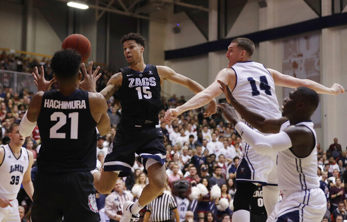 Gonzaga forward Brandon Clarke (15) passes to teammate Rui Hachimura (21) during the first half of an NCAA basketball game against Loyola Marymount Thursday, Feb. 14, 2019, in Los Angeles. (AP Photo/Marcio Jose Sanchez)