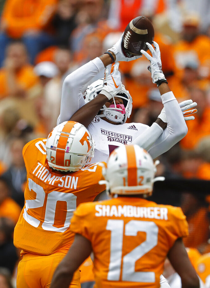 Mississippi State wide receiver Osirus Mitchell (5) tries to make a catch as he's hit by Tennessee defensive back Bryce Thompson (20) in the second half of an NCAA college football game Saturday, Oct. 12, 2019, in Knoxville, Tenn. (AP Photo/Wade Payne)