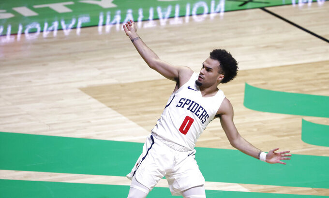 Richmond guard Jacob Gilyard reacts after making a 3-point basket against Mississippi State during the first half of an NCAA college basketball game in the semifinals of the NIT, Thursday, March 25, 2021, in Denton, Texas. (AP Photo/Ron Jenkins)