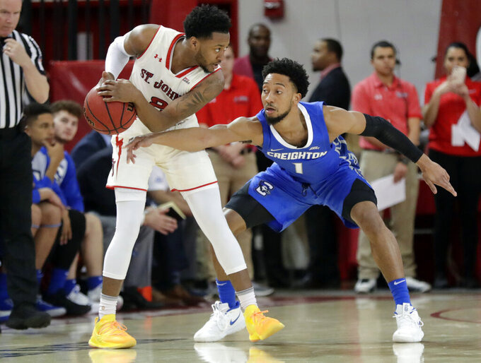 Creighton's Davion Mintz (1) defends St. John's Shamorie Ponds (2) during the first half of an NCAA college basketball game Wednesday, Jan. 16, 2019, in New York. (AP Photo/Frank Franklin II)
