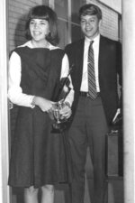 """This 1966 photo provided by Sen. Elizabeth Warren's campaign shows her with her high school debate partner after winning the Oklahoma state debate championship. Warren's childhood was steeped in financial insecurity. She often describes her Oklahoma upbringing as """"the ragged edge of the middle class."""" When Warren was a 12-year-old, her father suffered a heart attack and her mother went to work at Sears to help pay the bills. Her family couldn't afford college, but Warren parlayed her debating skills into a scholarship. (Elizabeth Warren campaign via AP)"""