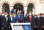 """Turkey's President Recep Tayyip Erdogan speaks after Eid al-Adha prayers at historical Hala Sultan Mosque, in Nicosia, Cyprus, Tuesday, July 20, 2021. Erdogan said Tuesday his country will talk with the Taliban regarding Turkey's bid to operate and secure the airport in the Afghan capital, Kabul. Speaking after Eid al-Adha prayers, President Erdogan acknowledged that the hardline Islamist group had some """"discomforts"""" over Turkey's proposed plans for Hamid Karzai International Airport.(Turkish Presidency via AP, Pool)"""