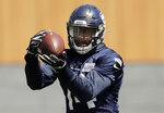 """In this Friday, May 3, 2019 photo, Seattle Seahawks rookie wide receiver DK Metcalf makes a catch during NFL football rookie mini camp in Renton, Wash. It took one rookie minicamp practice for Metcalf to catch the attention of Seahawks coach Pete Carroll. """"Maybe he's even more unique than we thought coming in,"""" Carroll says. (AP Photo/Ted S. Warren)"""