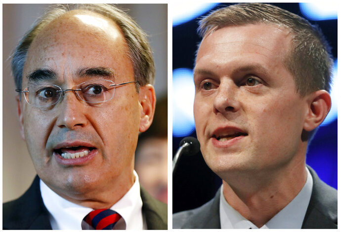FILE - This combination of file photos show U.S. Rep. Bruce Poliquin in 2017, left, and state Rep. Jared Golden in 2018, right, in Maine. Federal Judge Lance Walker has dismissed a lawsuit by Poliquin aimed to nullify outcome of first ranked choice congressional election won by Golden. (AP Photos/Robert F. Bukaty, File)