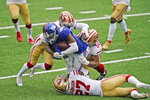 San Francisco 49ers defenders bring down New York Giants' Darius Slayton, center, during the second half of an NFL football game, Sunday, Sept. 27, 2020, in East Rutherford, N.J. (AP Photo/Corey Sipkin)