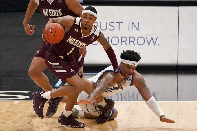 Missouri State's Isiaih Mosley (1) and Drake's Darnell Brodie chase a loose ball during the second half of an NCAA college basketball game in the semifinal round of the Missouri Valley Conference men's tournament Saturday, March 6, 2021, in St. Louis. (AP Photo/Jeff Roberson)