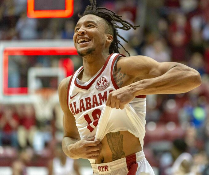 Alabama guard Dazon Ingram (12) reacts to Alabama forward Galin Smith (30) hitting a buzzer-beater against Mississippi during the first half of an NCAA college basketball game, Tuesday, Jan. 22, 2019, in Tuscaloosa, Ala. (AP Photo/Vasha Hunt)