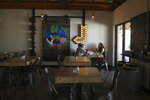 In this Friday, Oct. 18, 2019 photo, patrons dine at the Earth Plant Based Cuisine restaurant serving up Mexican vegan food in Phoenix. No longer just a few items on a mainstream restaurant's menu, vegan Mexican food has become a widening industry on its own with Latinos taking control of the kitchen. (AP Photo/Ross D. Franklin)