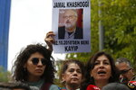 Activists, members of the Human Rights Association Istanbul branch, holding posters with photos of missing Saudi journalist Jamal Khashoggi, talk to members of the media, during a protest in his support near the Saudi Arabia consulate in Istanbul, Tuesday, Oct. 9, 2018. The poster reads in Turkish: ' Jamal Khashoggi, missing since October 2, 2018'. Khashoggi disappeared after entering Saudi Arabia's consulate to obtain paperwork required for his marriage to his Turkish fiancee. Turkish officials have alleged he was killed in the compound while Saudis officials said he left the building unharmed. (AP Photo/Lefteris Pitarakis)