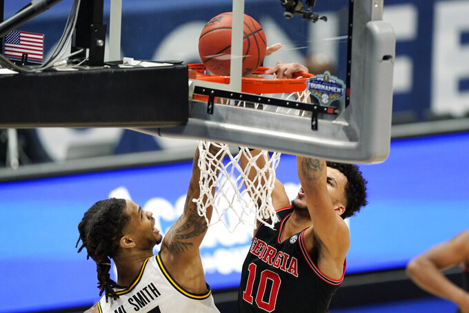 Georgia's Toumani Camara (10) dunks the ball against Missouri's Mitchell Smith in the first half of an NCAA college basketball game in the Southeastern Conference Tournament Thursday, March 11, 2021, in Nashville, Tenn. (AP Photo/Mark Humphrey)