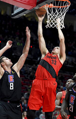 Portland Trail Blazers forward Zach Collins, right, shoots over Los Angeles Clippers forward Danilo Gallinari during the second half of an NBA basketball game in Portland, Ore., Thursday, Nov. 8, 2018. The Blazers won 116-105. (AP Photo/Steve Dykes)