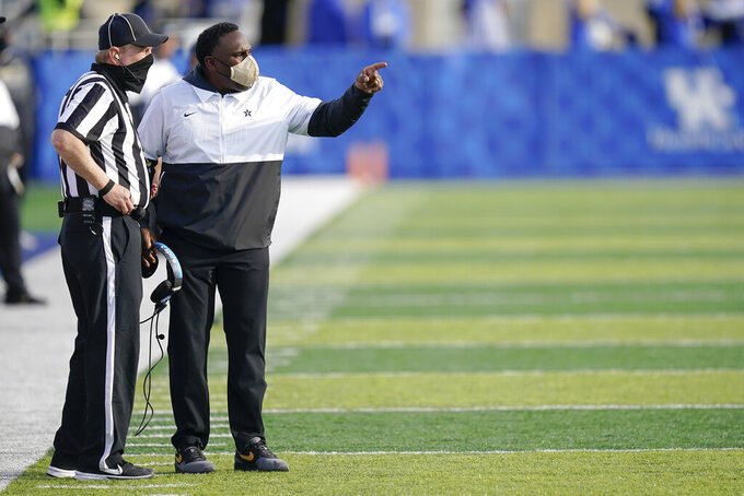 Vanderbilt head coach Derek Mason speaks with an official during the second half of an NCAA college football game against Kentucky, Saturday, Nov. 14, 2020, in Lexington, Ky. (AP Photo/Bryan Woolston)