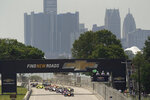 Pole sitter Pato O'Ward leads the field to the start line during the first race of the IndyCar Detroit Grand Prix auto racing doubleheader on Belle Isle in Detroit Saturday, June 12, 2021. (AP Photo/Paul Sancya)