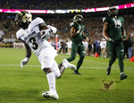 Colorado wide receiver K.D. Nixon, left, scores a touchdown after catching a pass as Colorado State safety Jamal Hicks, center, and cornerback V.J. Banks look on in the first half of an NCAA college football game Friday, Aug. 31, 2018, in Denver. (AP Photo/David Zalubowski)
