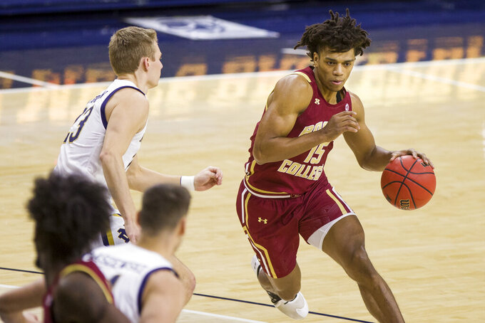 Boston College's DeMarr Langford Jr. (15) drives next to Notre Dame's Dane Goodwin (23) during the first half of an NCAA college basketball game Saturday, Jan. 16, 2021, in South Bend, Ind. (AP Photo/Robert Franklin)