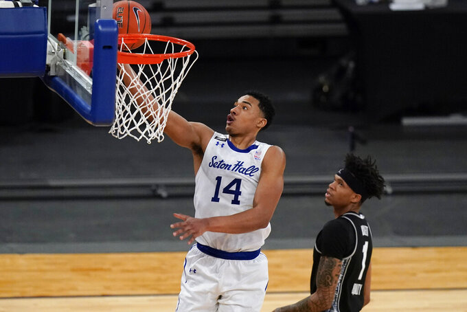 Seton Hall's Jared Rhoden (14) drives past Georgetown's Jamorko Pickett (1) during the second half of an NCAA college basketball game in the semifinals in the Big East men's tournament Friday, March 12, 2021, in New York. (AP Photo/Frank Franklin II)