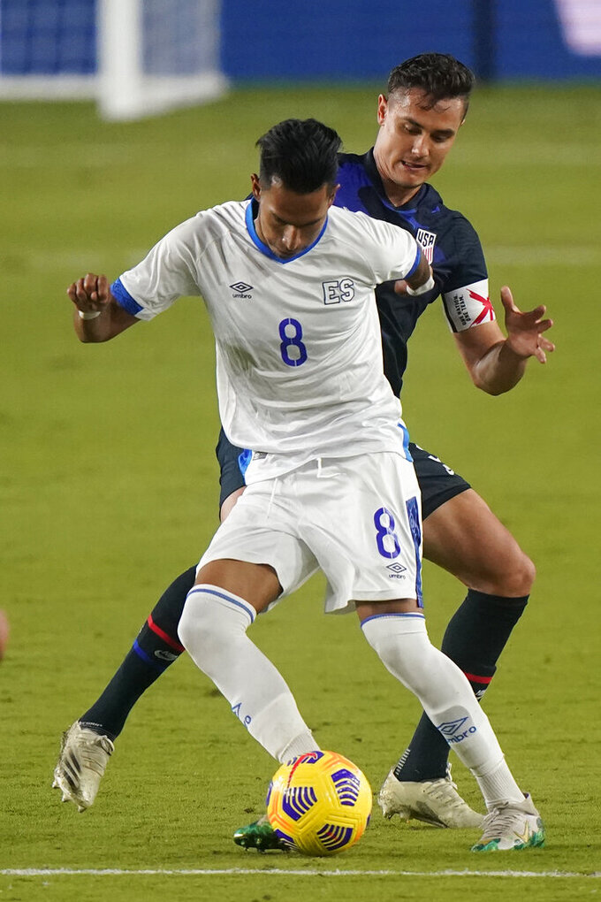 El Salvador midfielder Denis Pineda (8) and U.S. defender Aaron Long, rear, vie for the ball during the second half of an international friendly soccer match Wednesday, Dec. 9, 2020. in Fort Lauderdale, Fla. (AP Photo/Wilfredo Lee)