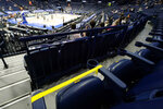 Seats are marked for social distancing at an NCAA college basketball game in the Southeastern Conference tournament Wednesday, March 10, 2021, in Nashville, Tenn. Large buildings with high ceilings and ventilation systems that can change out fresh air almost a third as well as airplanes are reasons why experts and engineers believe it's reasonable for limited numbers of fans to be returning to live, indoor sporting events. They say masks are still necessary, but most professional and big college arenas – like the ones that host NHL and NBA games and the NCAA Tournament – have the capacity to make it work and keep people from spreading the coronavirus. (AP Photo/Mark Humphrey)