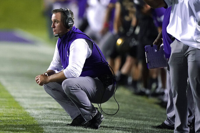 Northwestern coach Pat Fitzgerald watches during the second half of the team's NCAA college football game against Michigan State in Evanston, Ill., Friday, Sept. 3, 2021. Michigan State won 38-21. (AP Photo/Nam Y. Huh)