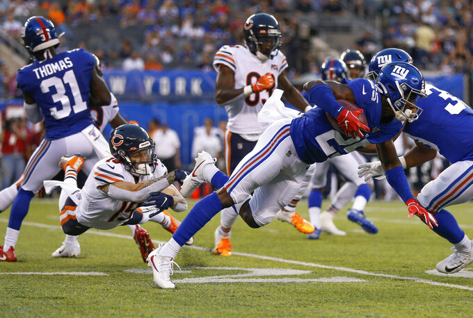 Chicago Bears wide receiver Tanner Gentry (19) trips up New York Giants defensive back Corey Ballentine (25) during the first quarter of a pre-season NFL football game, Friday, Aug. 16, 2019, in East Rutherford, N.J. (AP Photo/Adam Hunger)