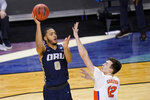Oral Roberts forward Kevin Obanor (0) shoots over Florida forward Colin Castleton (12) during the second half of a college basketball game in the second round of the NCAA tournament at Indiana Farmers Coliseum, Sunday, March 21, 2021 in Indianapolis. (AP Photo/AJ Mast)