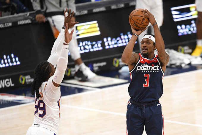 Washington Wizards guard Bradley Beal (3) shoots against Phoenix Suns forward Jae Crowder (99) during the second half of an NBA basketball game, Monday, Jan. 11, 2021, in Washington. (AP Photo/Nick Wass)