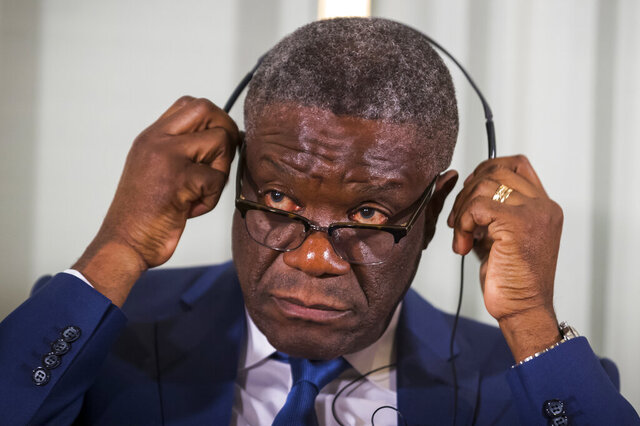 FILE - In this Sunday Dec. 9, 2018 file photo, Dr. Denis Mukwege from Congo prepares to listen to questions, with Nadia Murad from Iraq, at a media conference for the 2018 Nobel Laureates at the Nobel Institute in Oslo, Norway. The United Nations human rights chief on Friday, Aug. 28, 2020 called for a quick investigation into death threats against Congolese Nobel Peace Prize laureate Dr. Denis Mukwege, saying Mukwege is a