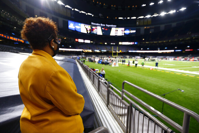 An usher watches as the New Orleans Saints and the Tampa Bay Buccaneers play in the Superdome without any fans, due to the COVID-19 pandemic, in the second half of an NFL football game in New Orleans, Sunday, Sept. 13, 2020.in the first half of an NFL football game in New Orleans, Sunday, Sept. 13, 2020. (AP Photo/Butch Dill)